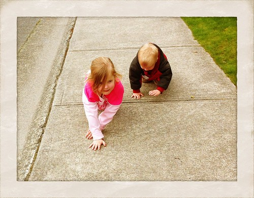 My kids playing puppy on a walk