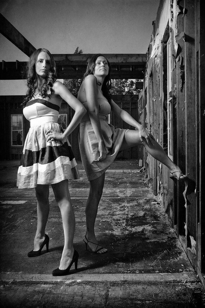 Two girls... posing.