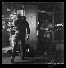 Guitar Man (Sean Molin Photography) Tags: blackandwhite bw 6x6 film contrast rollei rolleiflex mediumformat downtown ripple indianapolis streetphotography indy indiana scratches negative squareformat scanned april kodaktrix dust broad guitarplayer filmgrain streetmusician broadripple 2011 naptown kodakhc110 rolleiflex35fplanar film:iso=1600 film:brand=kodak film:name=kodaktrix400 developer:brand=kodak developer:name=kodakhc110 emulsionstain filmdev:recipe=6497