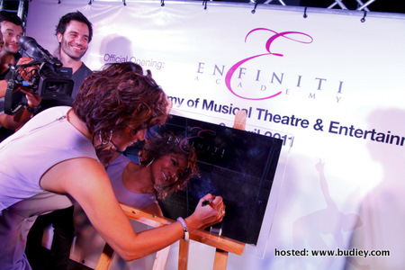 Tiara signing the official plaque 2