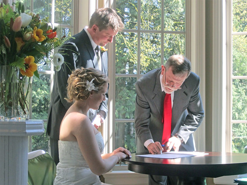 Bill signs the register