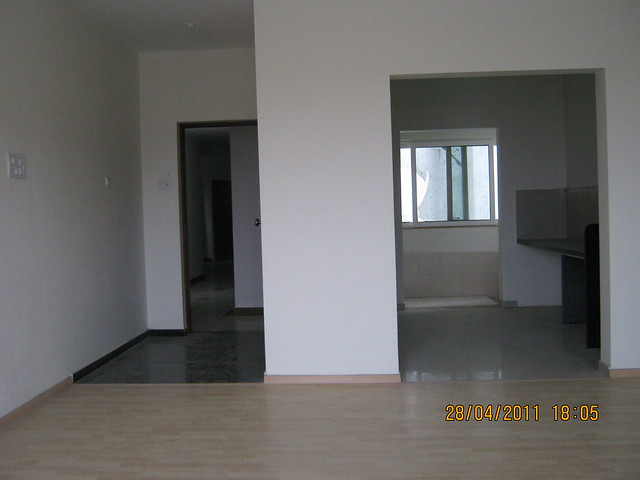 Entrance lobby and kitchen from the living cum dining of the flat in Sangria Towers, Megapolis Hinjewadi Phase 3