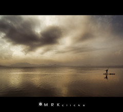 / On song (MRK Clicks) Tags: man water rain weather yellow clouds boat nikon rainy dying cwc mrk singingman kalki d40 waterbody chengalpet  1116mm chennaiweekendclickers mrkclicks kolavailake mrkbest lakekuzhavai  onsong