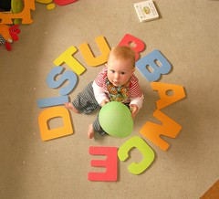disturbance - actions speak louder than words (Shamus O'Reilly) Tags: uk blue red orange baby playing silly cute green smile smiling yellow word toys happy funny gorgeous letters balloon creative multicoloured letter colourful oxfordshire wordplay pleased linguistics charlbury isogram jackethanoreilly
