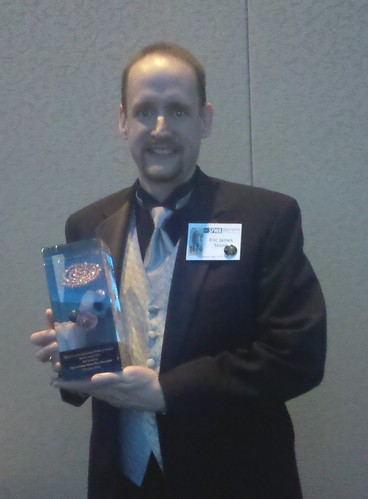 Eric James Stone with his Nebula Award