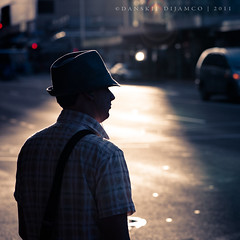 Candid shot #001 (Danskie.Dijamco.Photography) Tags: street sunset shadow man hat silhouette backlight nikon ipod candid streetphotography photojournalism scene mp3 snapshots checks 105mm scee checkeredshirt paparrazzi d700 danskie danskiedijamco