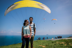 Manny+Angela ..! (photomaster.shifu) Tags: outings adventure paragliding photographer d300 kitlens photography starbursts sunrays sun jump mountain sea sky group blueskies 18140 taiwan taipei wanli specialshots specialmoments flying flyinghigh wind clouds ocean