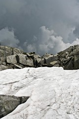 snow and stones (el_mo) Tags: cloud mountain snow storm dirty montagna temporale adamello blumone rifugiotitasecchi lagodellavacca