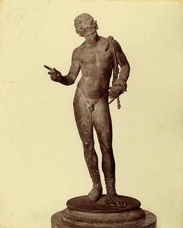 Bronze sculpture of Narcissus with a pelt tied around his shoulder from Vicolo del Balcon Pensile in Pompeii. Photo by Giorgio Sommer c. 1880. Penn Museum Object #153