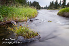 Smooth Water Effect as River Flows Around Rock (jim_david) Tags: longexposure motion blur nature water grass rock stone river landscape flow outdoors movement energy montana stream background stock smooth conservation blurred boulder environment serene flowing wilderness tranquil blackfoot
