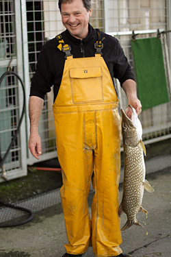 fisherman with brochet
