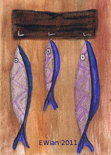 three little fishes hanging in a row 10