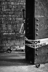 caution x 2. (stevenbley) Tags: nottingham blackandwhite bw white black mill abandoned contrast rust theater factory bell bokeh pennsylvania lace decay clocktower grease pa urbanexploration oil maze scranton grime breeze bowlingalley planks decayed woodfloors urbanexploring urbex sneak looms scrantonlace guerillahistorian