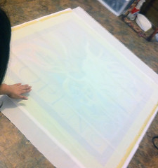 smoothing the silk and taping down (angel_ray) Tags: lady open oneofakind flag handpainted swirls brightcolors pinklips handpaintedsilk dayandnight angelray nouveauart custombanner silkcharmeuse uniquesign musesilkpaintings debrabenditzartstudios commissinedstoresign nouveaukiss
