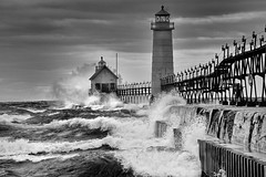 """September Gale"" Grand Haven Lighthouse - Grand Haven , Michigan (Michigan Nut) Tags: bw usa storm geotagged waves lakemichigan michiganlighthouses grandhavenlighthouse nikonnikkor70300mmf4556gedifafsvrtelephotozoomlens"