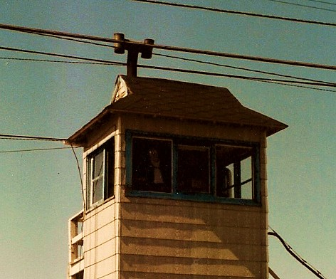 The manualally operated crossing gate operators tower on West 51st Street, at the GTW Elsdon Yard. (Gone.) Chicago Illinois USA. October 1983. by Eddie from Chicago