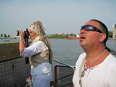 something big is passing by (Harry -[ The Travel ]- Marmot) Tags: boy people man holland water netherlands dutch sunglasses amsterdam ferry golden canal couple photographer crossing roman tail nederland sunny dailycommute chain pony commuting rasta vrouw emperor commuters ij gentle mensen gvb staart stel amsterdamnoord veerpont ijveer aardige deradlocks jordanezen