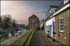 the city wall (Wim Koopman) Tags: city bridge sky house brick window water stone wall photography foot boat photo path walk stock hike ramparts footpath stroll stockphoto stockphotography leerdam wpk fortication