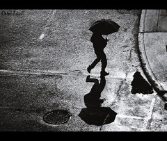 When it rains (1) [Front Page] (Michel Assaad) Tags: street white canada man black reflection silhouette marie night contrast umbrella canon dark spring downtown crossing quebec montreal memories bad dream 85mm it latin when series f18 raining ville rains quartier 550d t2i