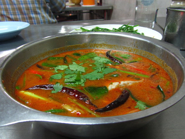 Spicy Thai soup with fish (tom yum pla ต้มยำปลา)