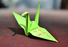good luck (Min_Max) Tags: red cute green beautiful closeup origami colorful dof cross handmade gift colourful lovely simple lightandshadow goodluck shallowdepthoffield giftidea shallowdof greenbird humanitarianaid origamibird paperbird japantsunami japantsunamiappeal goodluckinjapanese helpingpeopleinjapan birdofgoodluck