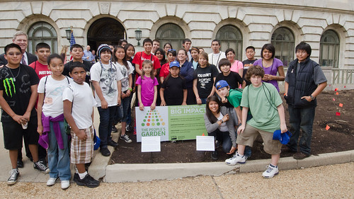 Agriculture Secretary Tom Vilsack (left rear of group) met with more than 30 Students from Eastern and Western Tribes, Southeast Alaska, and Tuba City, Arizona who came to the Nation's Capitol to plant vegetable seeds that are indigenous to North America.  The garden is called The Roots of American Agriculture, and is part of the Headquarters' People's Garden. The event took place on Wednesday, April 27, 2011 at the U.S. Department of Agriculture in Washington, DC. USDA Photo by Lance Cheung.