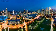 Electrifying Marina Bay! (DanielKHC) Tags: city blue light skyline museum digital marina river hotel 1 bay high flyer nikon singapore long exposure cityscape dynamic dusk trails quay fisheye explore hour clark esplanade cbd stamford sands suntec range dri beams hdr theatres mbs blending swissotel d300 artscience danielcheong nikkorfisheye105mmf28 danielkhc