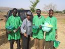 Me distributing supplies to farmers