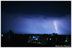 Silence, lonelines means there is a storm passing inside you... (Meghdut Gorai) Tags: city blue storm rooftop night clouds 35mm landscape town nikon cityscape wideangle stormy nightsky lightning lightningstrike nikon35mm lightningflash stormnight d5000 timerphoto afs35mmf18g nikond5000