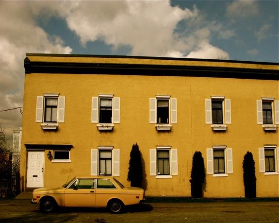 yellow building car