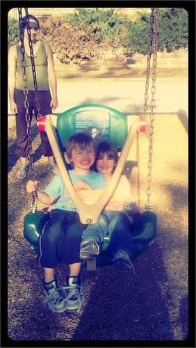 Judah and Grace on the swing