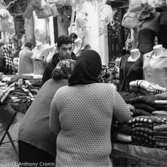 Customer Service at the cardigan stall Souk Tripoli Old Town (Anthony Cronin) Tags: 6x6 analog square photography all rights souk neopan agfa libya tripoli reserved folders agfaisolette xtol isolette foldingcamera 500x500 streetsphotography fujineopan greensquare solinar libyans agfaisoletteiii film:iso=400 kodakxtol film:brand=fuji formatfolding january2011 anthonycronin filmdev:recipe=5418 developer:brand=kodak developer:name=kodakxtol film:name=fujineopan400 iiicolor skoparmedium camera6x6120filmdevrecipe5418fuji neopankodak xtolfilmbrandfujifilmnamefuji 400filmiso400developerbrandkodakdevelopernamekodak tripolisouk tpastreet tripolioldtown analog streetphotographyagfa photangoirl