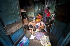 Family in Kolkata Slum (United Nations Photo) Tags: poverty light red india unitednations kolkata slum unphoto sonagachi