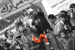 Abusing Mubarak (in his orange jumpsuit) in Tahrir square 8/4/2011 (Amir Abdel Shafy) Tags: orange streets slr alexandria youth canon square happy photography rebel freedom march kiss peace jan flag january egypt free peaceful social down 11 victory cleaning clean celebration suit cairo step 25 revolution egyptian amir gathering marching million his network 25th february feb dslr activists execute activist cyber uprising celebrating mohamed jumpsuit millions facebook xsi violent execution nonviolent mubarak mobarak tahrir abusing suez egyptians twitter hosny amirphotography sweap sweaping 842011