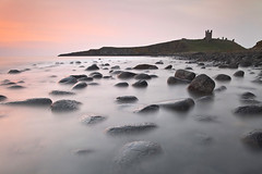 Dunstanburgh Sunrise (peterspencer49) Tags: ocean uk longexposure greatbritain england seascape castle clouds sunrise coast europe pebbles cliffs northumberland coastline seaview coastalpath dunstanburgh stunningview seascene oceanveiw cliffwalks 5dmkll peterspencer unitedkingdem stunningseascape coastalledges