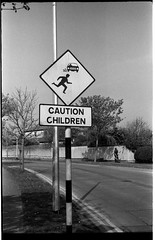 caution children (Mark Waldron) Tags: ireland blackandwhite dublin film sign 35mm children photography mark rangefinder 150 hedge caution fed2 rodinal ilford fp4 waldron 20c yellowfilter 502 strimmer jupiter8 skerries kmz 18mins