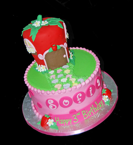 pink red and bright green polka dot 3rd birthday cake with a strawberry house for a Strawberry Shortcake Celebration