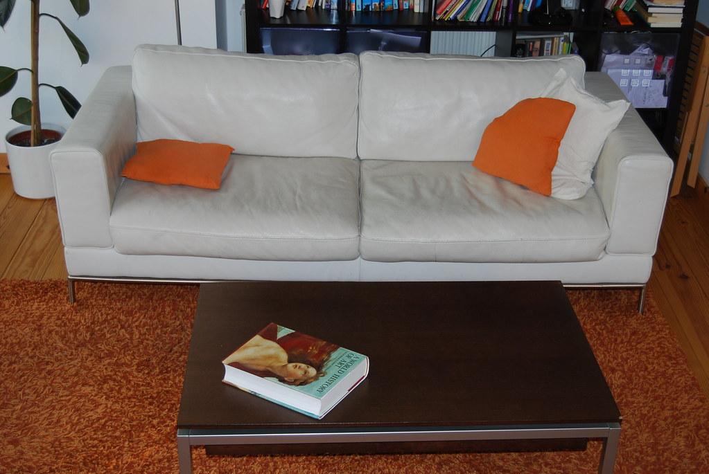 White leader sofa, designer carpet and coffe table