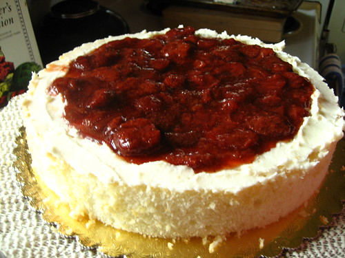 white velvet cake with homemade strawberry conserves and crispy white frosting