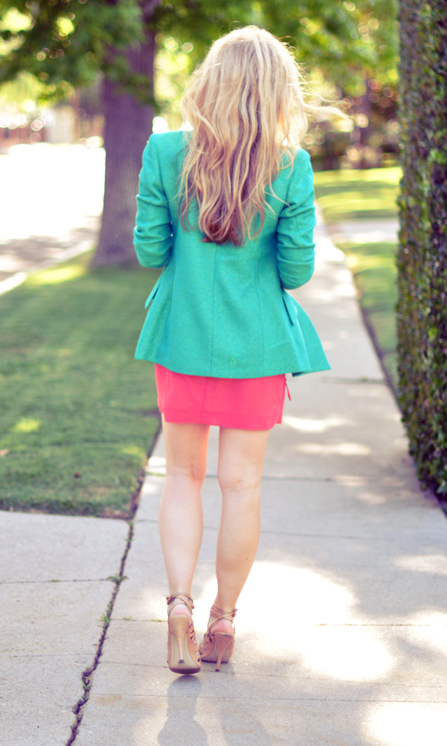 back of hair and green blazer coral dress and nude ankle heels
