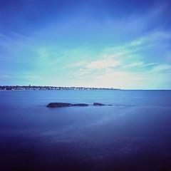 Easton Bay (Dr. RawheaD) Tags: ocean longexposure blue sea sky beach water clouds still fuji f45 hasselblad rhodeisland newport provia 100f carlzeiss 38mm biogon swcm