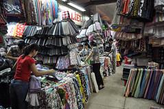 tissus everywhere (Nijule) Tags: stand nikon market vietnam asie saigon march hcmc tissu cholon 2011 d90 vendeuse hochiminhville binhtay flickrchallengegroup