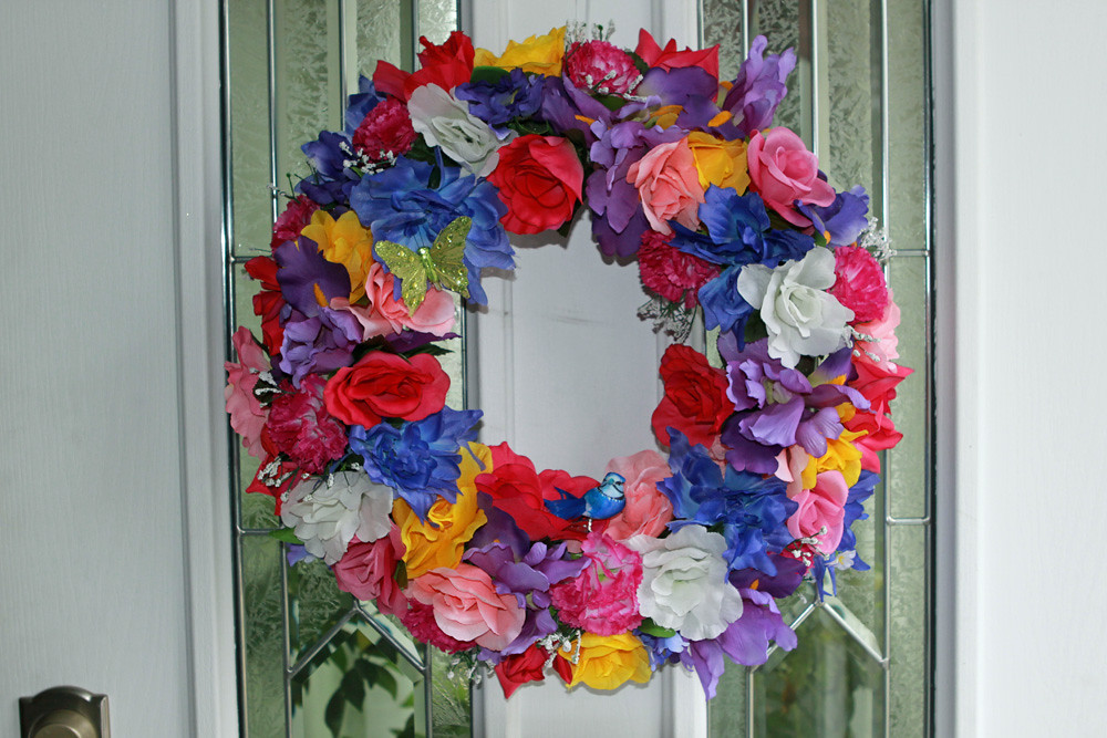 Spring/Summer multicolored floral wreath with blue bird and butterfly