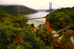 Foggy Skies over Bear Mountain Bridge (SunnyDazzled) Tags: bridge autumn trees newyork fog train river landscape colorful foggy scenic pedestrian bearmountain hudson