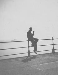 Pipe Dream (robin-loo) Tags: england silhouette pipe smoking scarborough smoker vintagephoto pipesmoker
