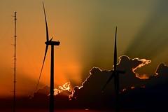 Sunrise behind wind farm (David Lieberman Photography) Tags: sunrise clouds light blue orange silhouette d7100 sunburst tower landscape wind farm morning energy electricity nikon