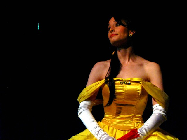 Belle (Kat Steel), Ally's confidant. 'Why, Ally, you look positively glum! What's the matter?'