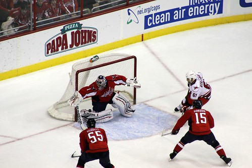 Semyon Varlamov makes the save as Cory Stillman looks for a rebound.