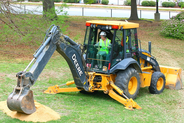 Library Dean uses a Backhoe