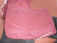 Cutting up old clothes to crochet a bag